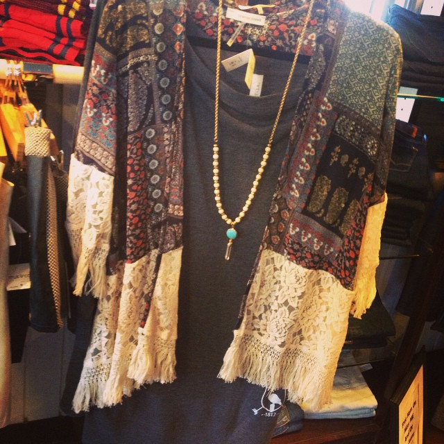 Patterned cardigan with lace, fringe trim $46