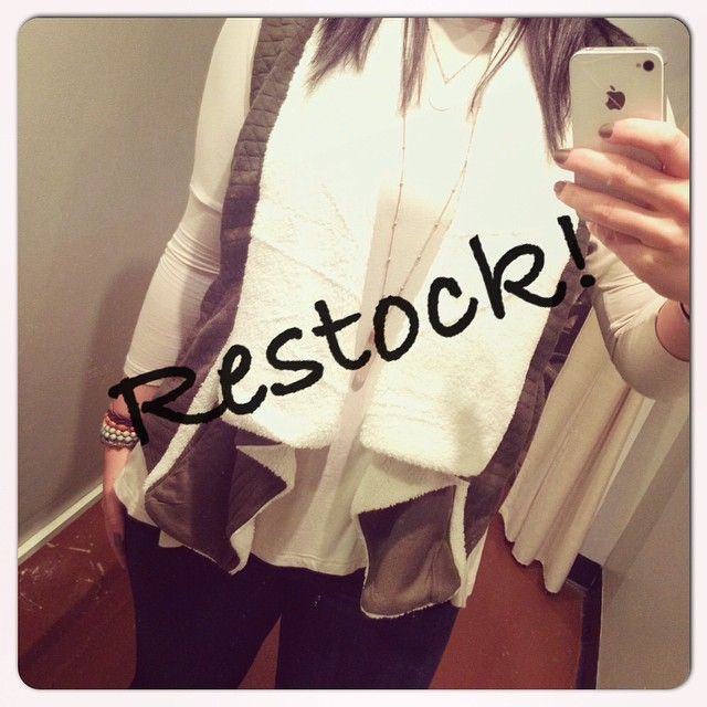 Restock on this oh so perfect olive/cream fur vest!