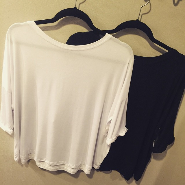 New black and white roll sleeve piko tops, $26!