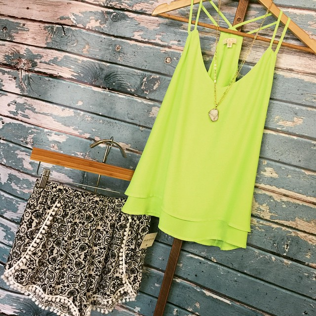 Talk about Spring ️ Check out our new neon strappy tank $28 paired with our navy printed shorts $26