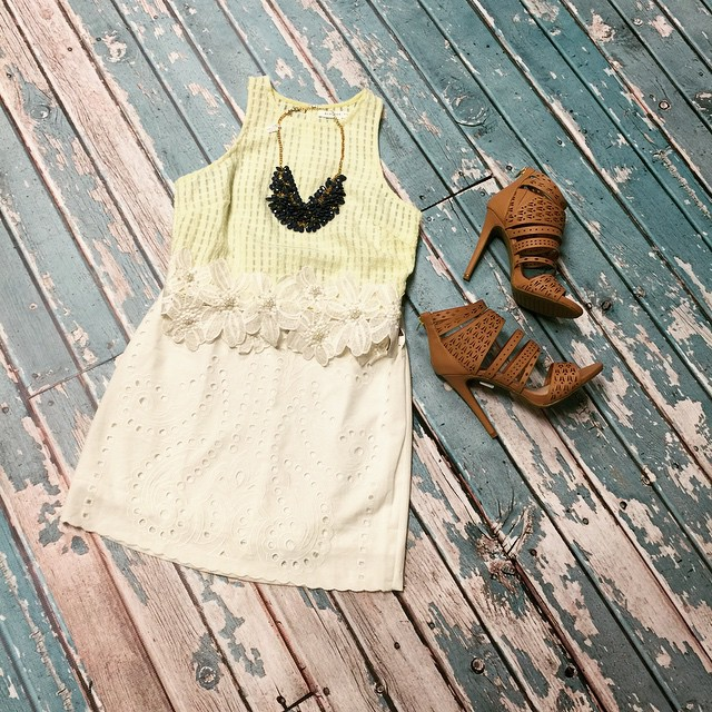 Spring has arrived with this new yellow lace crop top!