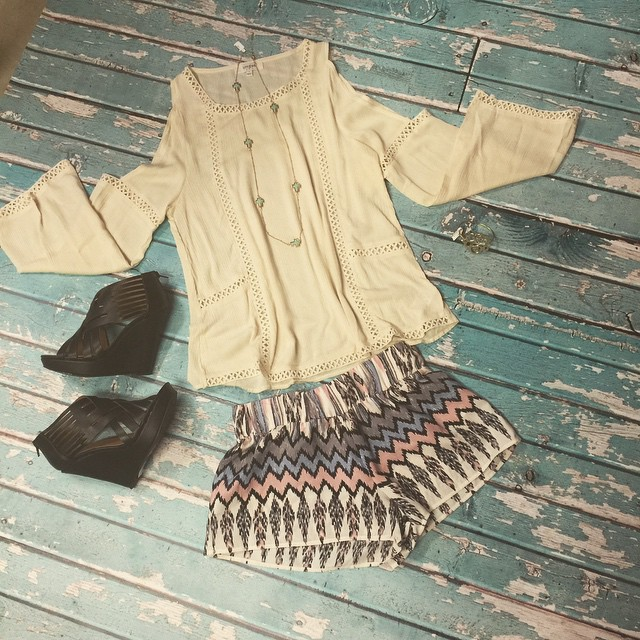 Dress this casual shorts and top outfit up with a pair of our sassy black wedges and gold jewelry  for any day or evening out on the town! Top $36 Shorts $38 Wedges $45 Necklace $20 Initial Bracelet $14