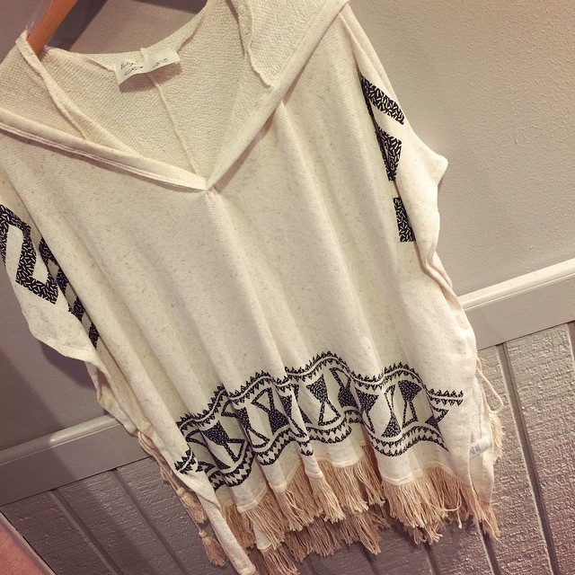 This new ivory Aztec fringe poncho is a must have! Yes, even for the warm weather it won't be too much! $58.00