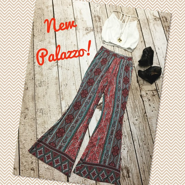 Check out these sassy new flared palazzo pants paired with a gold trimmed white crop top and a pair of our black wedges to add the perfect amount of height! Pants $32 Top $26 Wedges $45 Necklace $22
