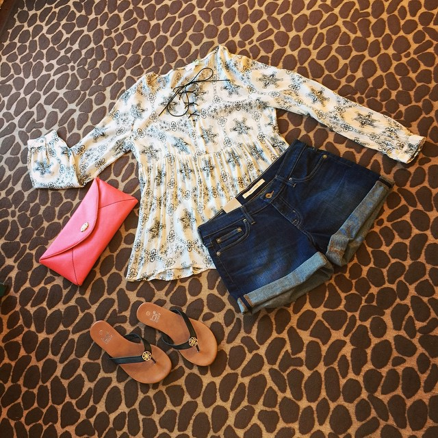 New printed tie up tunic top paired with our cuffed Big Star denim shorts, black sandals and add a fun colored clutch to top off this cute outfit! Top $32 Shorts $74 Sandals $14 Clutch $22